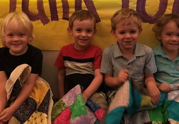 Children at Sojourner Receive Quilts From Natural Choice Academy